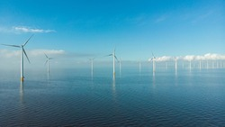 Windmill row of windmills in the ocean by the lake Ijsselmeer Netherlands, renewable energy windmill farm Flevoland