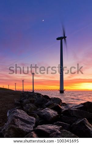 Windmill sunset rocks
