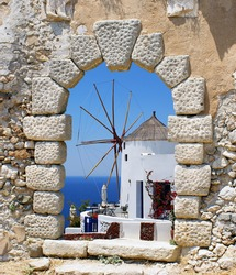 Windmill through an old Venetian window, Greece