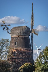 Windmill with a  in the background