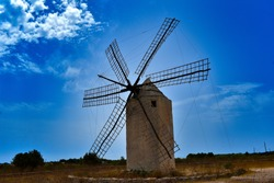 windmill with blue sky background, formentera Spain