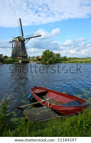 Windmill with Red boat in Holland