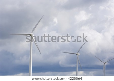 Windmill with storm clouds in the background - stock photo