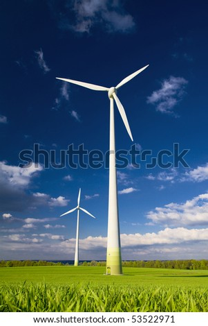 Windmills against a blue sky and clouds, alternative energy source