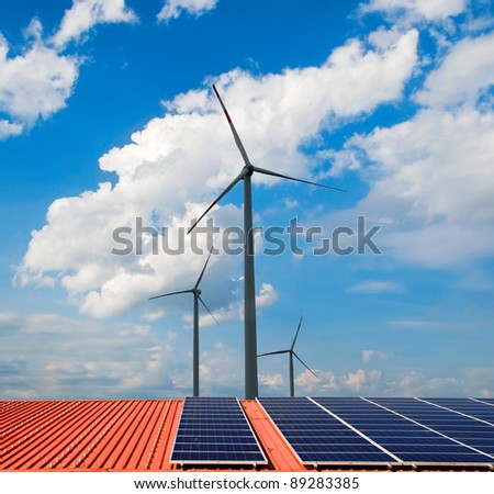 Windmills and solar panels on orange roof