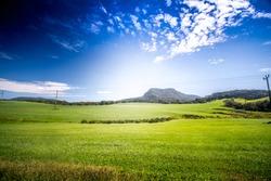 Windmills at Ambewela New Zealand farm on a beautiful sunny day in Sri Lanka