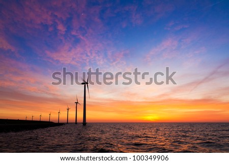 Windmills at sunset at the water