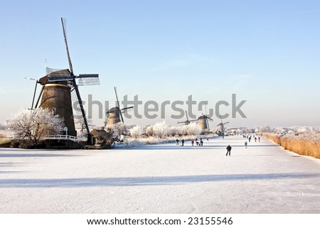 Windmills at the Kinderdijk in wintertime in the Netherlands - stock photo
