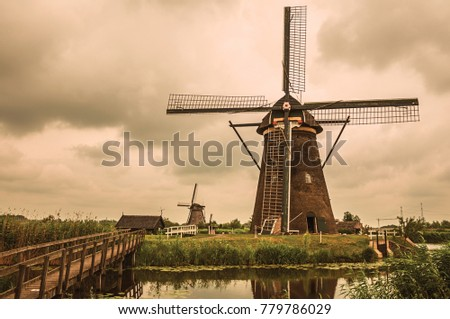 windmills  bushes and canal in...