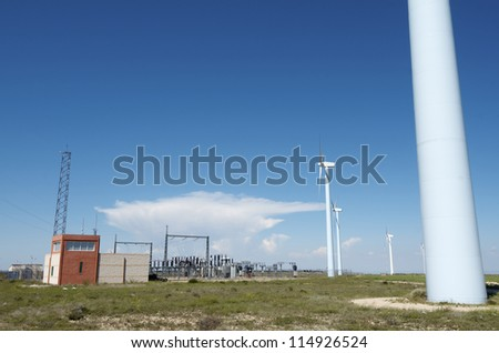 windmills for  electric power production and  electrical substation