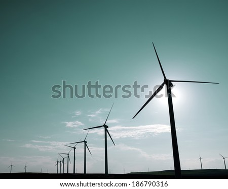 Windmills for electric power production at sunset Pozuelo de Aragon Zaragoza Aragon Spain