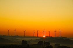 windmills for electricity generation at sunrise in Germany