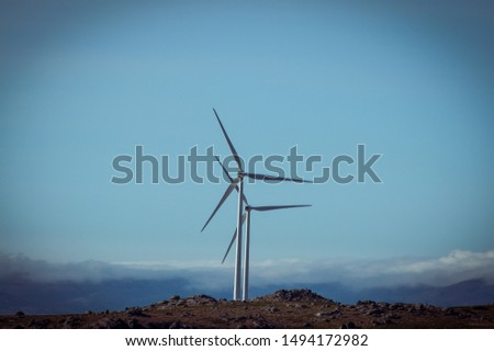 Windmills generating electricity in the clouds / alternative energy / beautiful view. #1494172982