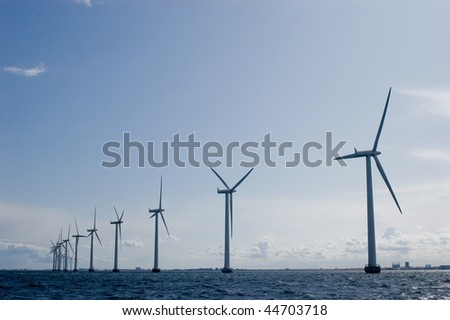 Windmills in a row with clear sky