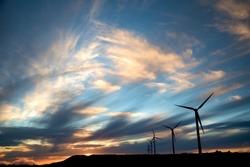 Windmills in sunset on Paul da Serra plain, Madeira island, Portugal