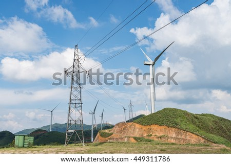 Windmills in the background of the blue sky white clouds #449311786