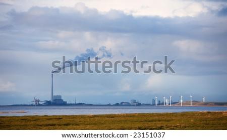 Windmills in the Danish Marsh Near Esbjerg, Denmark is a very big windmill farm.