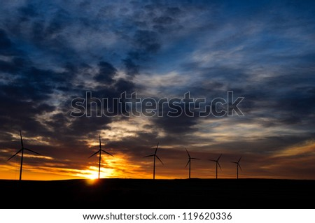 Windmills in the prairies at Sunrise, Alberta Canada