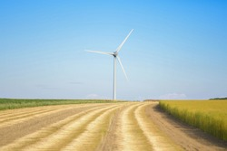 Windmills near the field of flax Normandy France
