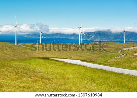 Windmills near the sea producing clean energy at Maloy island, Norway