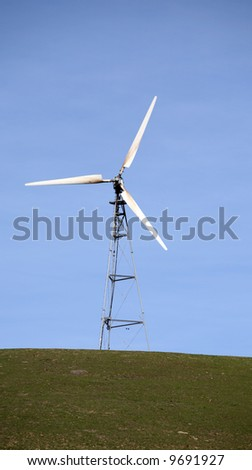 Windmills on a hill generate electricty - stock photo