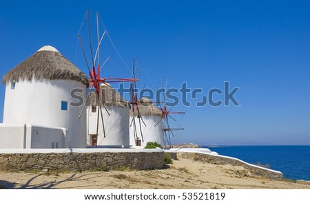 Windmills on a hill near the sea on the island of Mykonos - a place that must attend