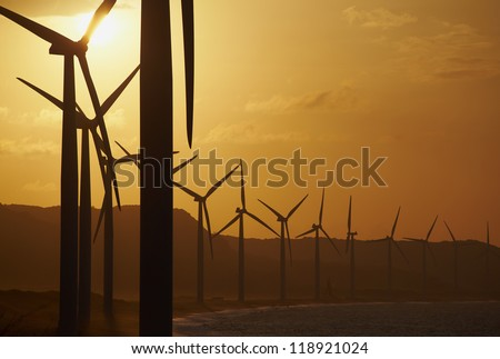 Windmills on the sea cost against sunset, north Philippines