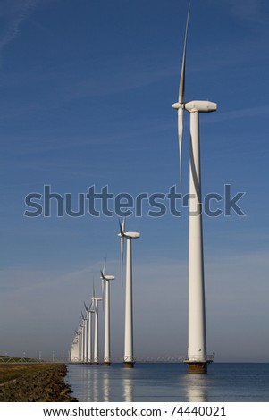 Windmills standing in the water