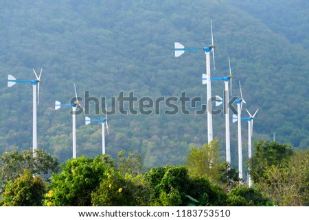Windmills the alternative and sustainability of enery from natural at His Majesty King Bhumibol Adulyadej's Royal Initiative project know as Chang Hua Mun in Phetchaburi Thailand.