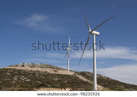 Windmills using as alternative energy source - stock photo