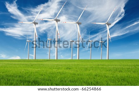windmills with fresh green grass and beautiful blue sky