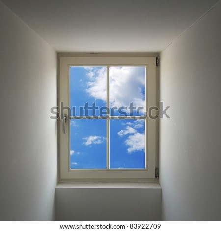window and blue sky showing freedom concept with copyspace