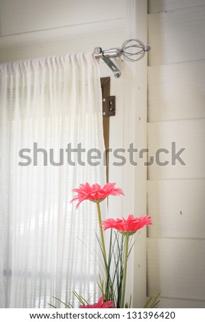 window and pink flowers
