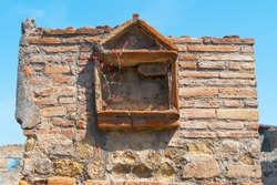 Window at Ancient ruins of Pompei city, near Napoly, Italy.