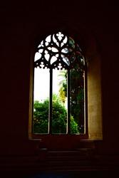 Window at church in Palma de Mallorca. View to garden. Window to heaven.