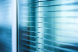 window blinds close up in the office building with blue color tone effect
