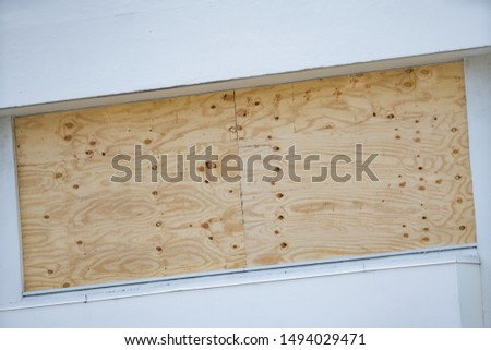 Window boarded up for hurricane severe weather
