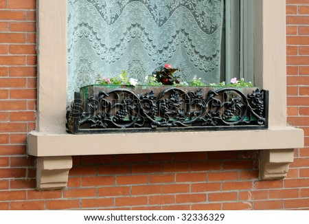 Window Box with floral pattern. Classic, elegant and simple wrought iron decoration