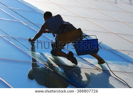 Window cleaner works on high rise building.Window cleaning is considered one of the most dangerous job in the world.