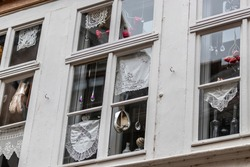 Window decorations with shoes and doilies on a house in Erfurt, thuringia