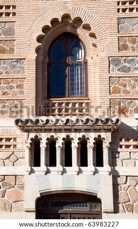 Window, detail on building of train station in Toledo, Spain
