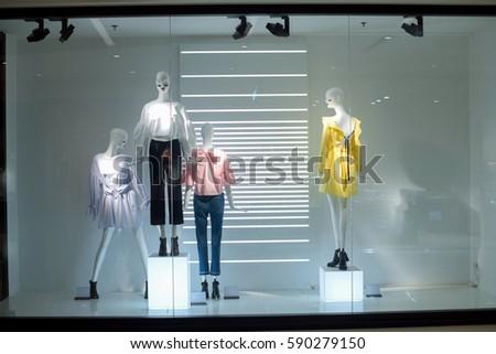 window display mannequin in storefront  #590279150