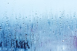 Window glass with condensation, high humidity. Texture of water  background. Photo of the phenomenon of nature
