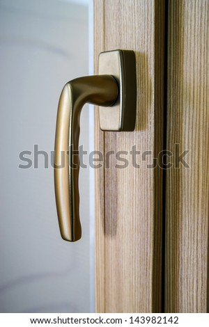 Window handle on fiberglass window. Gold color. Interior design.