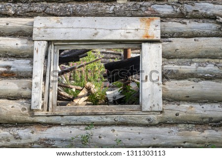 Window in an abandoned cabin in Silver City ghost town, Yukon Territory, Canada