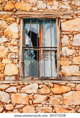 Window in an old house in the village Psarades near lake Prespa in Northern Greece