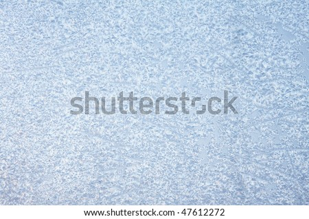 Window in ice in the winter