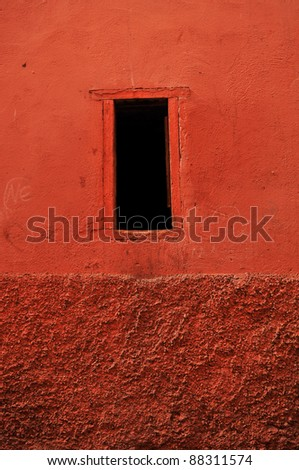 window in Marrakech's medina (old town). In Marrakech the houses are traditionally pink. Morocco.