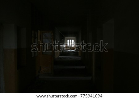 Window in the old hallway of an abandoned hospital . #775941094