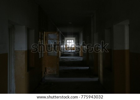 Window in the old hallway of an abandoned hospital  #775943032